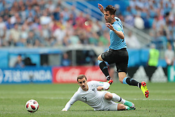 July 6, 2018 - Nizhny Novgorod, U.S. - NIZHNY NOVGOROD, RUSSIA - JULY 06: forward Antoine Griezmann of France in action with midfielder Rodrigo Bentancur of Uruguay during the Quarter-Final match between Uruguay and France in the 2018 FIFA World Cup on July 6, 2018, at Nizhny Novgorod Stadium in Nizhny Novgorod, Russia. (Photo by Anatoliy Medved/Icon Sportswire) (Credit Image: © Anatoliy Medved/Icon SMI via ZUMA Press)