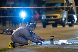 © Licensed to London News Pictures. 09/03/2021. London, UK. Forensic investigators gather evidence inside a cordon after Metropolitan Police closed off Poynders Road in Clapham in what is believed to be connected to the search for missing person Sarah Everard. Photo credit: Peter Manning/LNP