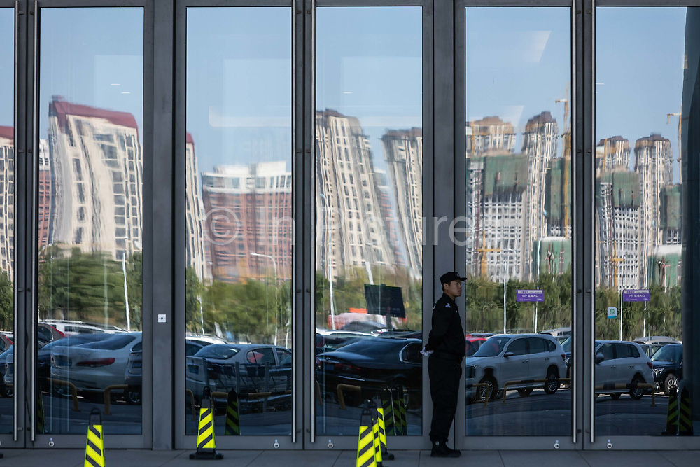 New contractions for apartment buildings are seen reflected in distortion on the glass panel of a Wal-Mart Stores Inc. owned and operated Sams Club store during its opening day in Tianjin, China, on Wednesday, Sept. 28, 2016.