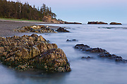 Natural arch (Hole in the Wall) and exposed bedrock at dusk, West Coast Trail, British Columbia, Canada.