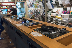 © Licensed to London News Pictures. 29/08/2020. LONDON, UK. Turntables in Phonica Records. Analogue music fans visit independent record shops in Soho to celebrate vinyl music on the rescheduled 13th Record Store Day, originally planned for April, but postponed due to the coronavirus pandemic.  Over 200 independent record shops across the UK come together annually to celebrate the unique culture of analogue music with special vinyl releases made exclusively for the day.  Sales of vinyl have risen, with 4.3m records sold in the UK during 2019, more than a 12-fold increase on the levels seen in 2011. Photo credit: Stephen Chung/LNP