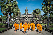 Monks walk up to the entrance of Angkor Wat in Siem Reap, Cambodia.