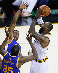 The Golden State Warriors' Andre Iguodala and Kevin Durant (35) contest the Cleveland Cavaliers' LeBron James, right, in the fourth quarter during Game 4 of the NBA Finals at Quicken Loans Arena in Cleveland on Friday, June 9, 2017. The Cavs won, 137-116, trimming their series deficit to 3-1. (Photo by Leah Klafczynski/Akron Beacon Journal/TNS) *** Please Use Credit from Credit Field ***