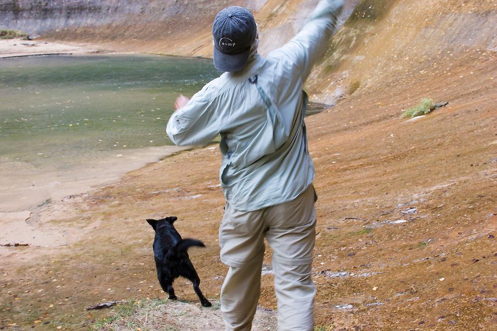 Black dog fetching stick, Lower Calf Creek Falls, Escalante National Monument, Utah<br />