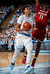 CHAPEL HILL, NC - FEBRUARY 05: Cameron Johnson #13 of the North Carolina Tar Heels drives to the basket during a game against the North Carolina State Wolfpack on February 05, 2019 at the Dean Smith Center in Chapel Hill, North Carolina. North Carolina won 113-96. North Carolina wore retro uniforms to honor the 50th anniversary of the 1967-69 team. (Photo by Peyton Williams/UNC/Getty Images) *** Local Caption *** Cameron Johnson