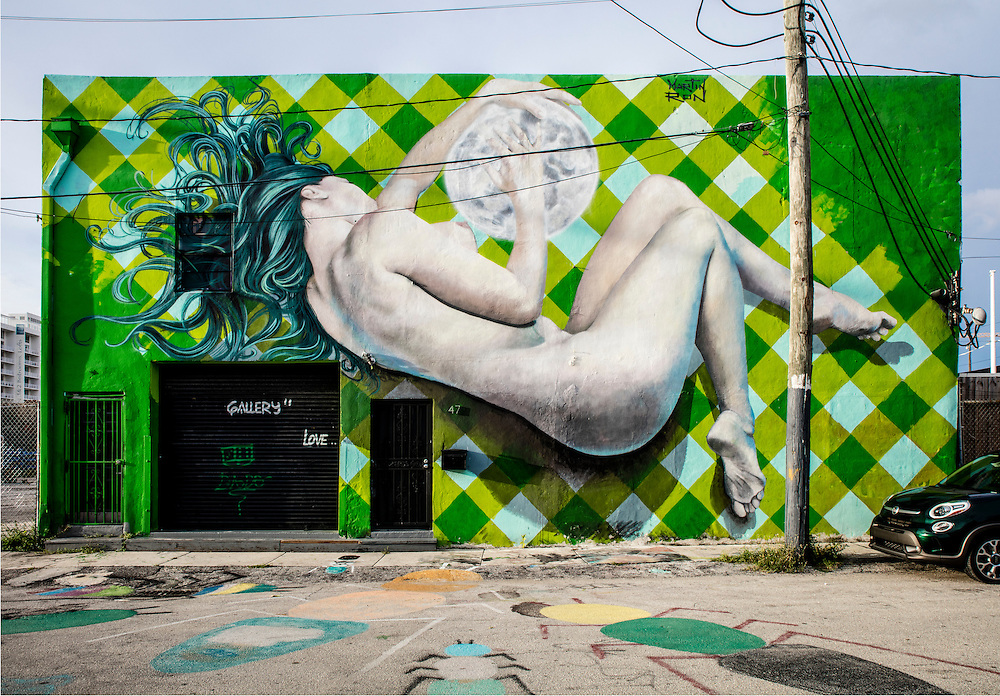 A painted nude covers almost all of a two-story building in Miami'a Wynwood street art district.