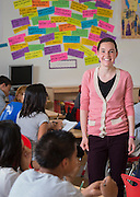 Sarah Rabourn works with her eighth grade social studio students at Sugar Grove Academy, April 28, 2014.