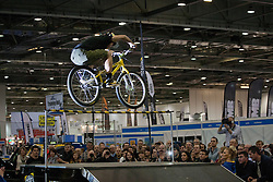 © licensed to London News Pictures. London, UK 12/01/12. Former World Champion trials rider Martyn Ashton performing for Animal Bike Tour at the London Bike Show in ExCel. Photo credit: Tolga Akmen/LNP