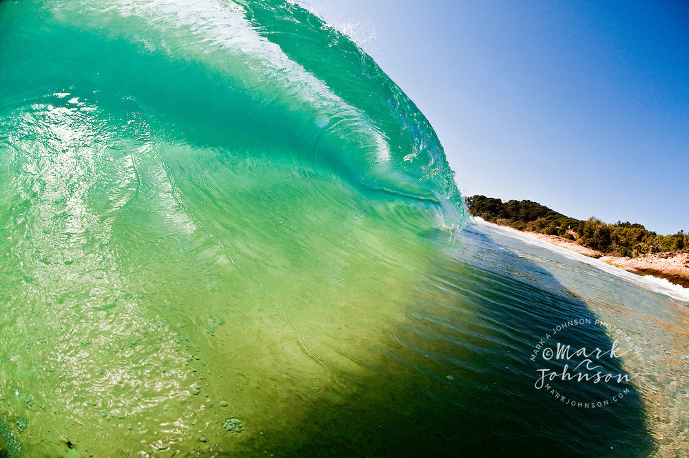 Beautiful breaking wave off the coast of Queensland, Australia