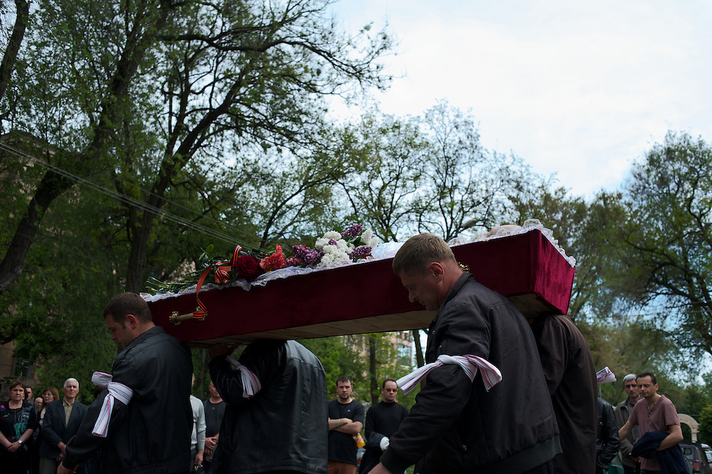 Family and friends carry the coffin of Alexey Vorobyov, a bystander shot dead two days earlier during a gunfight between Ukrainian soldier and armed pro-Russia separatist groups in central Mariupol, eastern Ukraine.