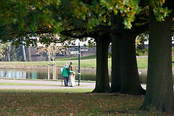 An old couple read an information board in Weston Park Sheffield<br /> 21 October 2012<br /> Image © Paul David Drabble