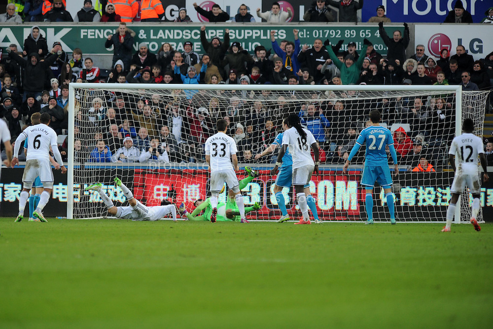 Ki Sung-Yueng of Swansea city (on ground) scores his teams 1st goal to make it 1-1. Barclays premier league match, Swansea city v Sunderland at the Liberty stadium in Swansea, South Wales on Saturday 7th Feb 2015.<br /> pic by Andrew Orchard, Andrew Orchard sports photography.