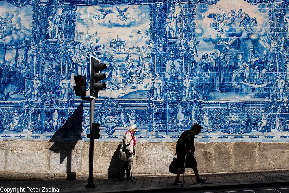 Elder people walking next a church in Porto, Portugal.