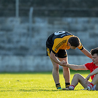 An Eire Og Player is consoled by Coolmeen's Mark Meaney