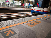 14 JULY 2011 - BANGKOK, THAILAND:   A BTS Skytrain pulls into the Nana Station on the Sukhumvit line. The Bangkok Mass Transit System, commonly known as the BTS Skytrain, is an elevated rapid transit system in Bangkok, Thailand. It is operated by Bangkok Mass Transit System Public Company Limited (BTSC) under a concession granted by the Bangkok Metropolitan Administration (BMA). The system consists of twenty-three stations along two lines: the Sukhumvit line running northwards and eastwards, terminating at Mo Chit and On Nut respectively, and the Silom line which plies Silom and Sathon Roads, the Central Business District of Bangkok, terminating at the National Stadium and Wongwian Yai. The lines interchange at Siam Station and have a combined route distance of 55 km.    PHOTO BY JACK KURTZ