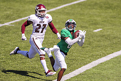 Sep 5, 2020; Huntington, West Virginia, USA; Marshall Thundering Herd wide receiver Jaron Woodyard (0) catches a touchdown pass while Eastern Kentucky Colonels defensive back Daulson Fitzpatrick (27) defends during the second quarter at Joan C. Edwards Stadium. Mandatory Credit: Ben Queen-USA TODAY Sports