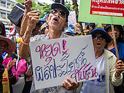 03 SEPTEMBER 2013 - BANGKOK, THAILAND:  A man protesting the price of cooking gas chants in front of Government House Tuesday. The Thai government raised the price of Liquified Propane Gas (LPG - cooking gas) by 50 satang per kilogram (about 1.5 cents US) over the weekend. The price of electricity and highway tolls also went up on the same day dealing most Thais a triple blow. The Thai consumers foundation has filed a suit in Thai administrative courts to block the increase but the courts have not yet ruled on the case. About 50 people protested the price hike at Government House in Bangkok and delivered a letter outlining their objections to a representative of the Prime Minister.   PHOTO BY JACK KURTZ