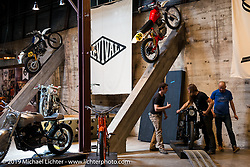 Aland Stulberg, Stefan Hertel and Chris from Revival set a bike in position on Friday before the grand opening that evening of the Handbuilt Motorcycle Show. Austin, TX. April 10, 2015.  Photography ©2015 Michael Lichter.