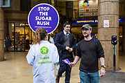 Oxfam supporters outside Hammersmith Tube station and the Coca Cola headquarters, calling for the company to tighten its supply chain so that the ingredients Coca Cola uses in its products are not grown on land that has been grabbed from poor communities