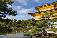 17. Kinkakuji 金閣寺 Temple of the Golden Pavilion was built in 1393 as a retirement villa for Shogun Yoshimitsu Ashikaga.  He intended to cover the entire exterior of the pavilion with gold, but only managed to coat the third floor with gold leaf before his death.  After his death, his son converted the building into a Zen temple of the Rinzai school named Rokuonji in accordance with Ashikaga's wishes.  He also managed to get the first and second stories covered in gold leaf as it stands today.  This architectural treasure, reflecting in its surrounding pond, is a masterpiece of Japanese aesthetics