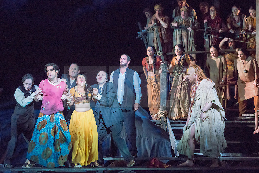 © Licensed to London News Pictures. 13/06/2014. London, UK. English National Opera perform Bizet's The Pearl Fishers at the London Coliseum. Picture features: John Tesslier as Nadir, Sophie Bevan as Leila, George von Bergen as Zurga and Barnaby Rea as Nourabad. Photo credit : Tony Nandi/LNP