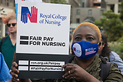 A NHS nurse prepares to march from St Thomas Hospital to Downing Street to protest against the NHS Pay Review Bodys recommendation of a 3% pay rise for NHS staff in England on 30th July 2021 in London, United Kingdom. The protest march was supported by Unite the union, which has called on incoming NHS England Chief Executive Amanda Pritchard to ensure that a NHS pay rise comes from new Treasury funds rather than existing NHS budgets and which is shortly expected to put a consultative ballot for industrial action to its members.