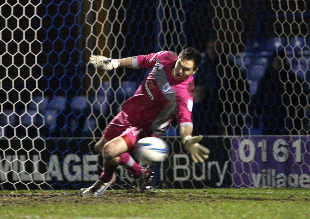 Preston North End's Thorsten Stuckmann  makes the vital penalty save in the shootout..Football - Johnstone's Paint Northern Area Quarter Final - Bury v Preston North End - Tuesday 18th December 2012 - Gigg Lane - Bury. .