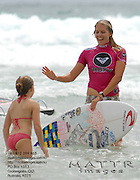 Gold Coast, Australia - March 6: Steph Gilmore high fives a grommet after the final of the Roxy Pro Gold Coast 2010 at Snapper Rocks on the Gold Coast, March 6, 2010 Photo by Matt Roberts/MATTRimages.com.au | Image ID: MTR_6333.jpg