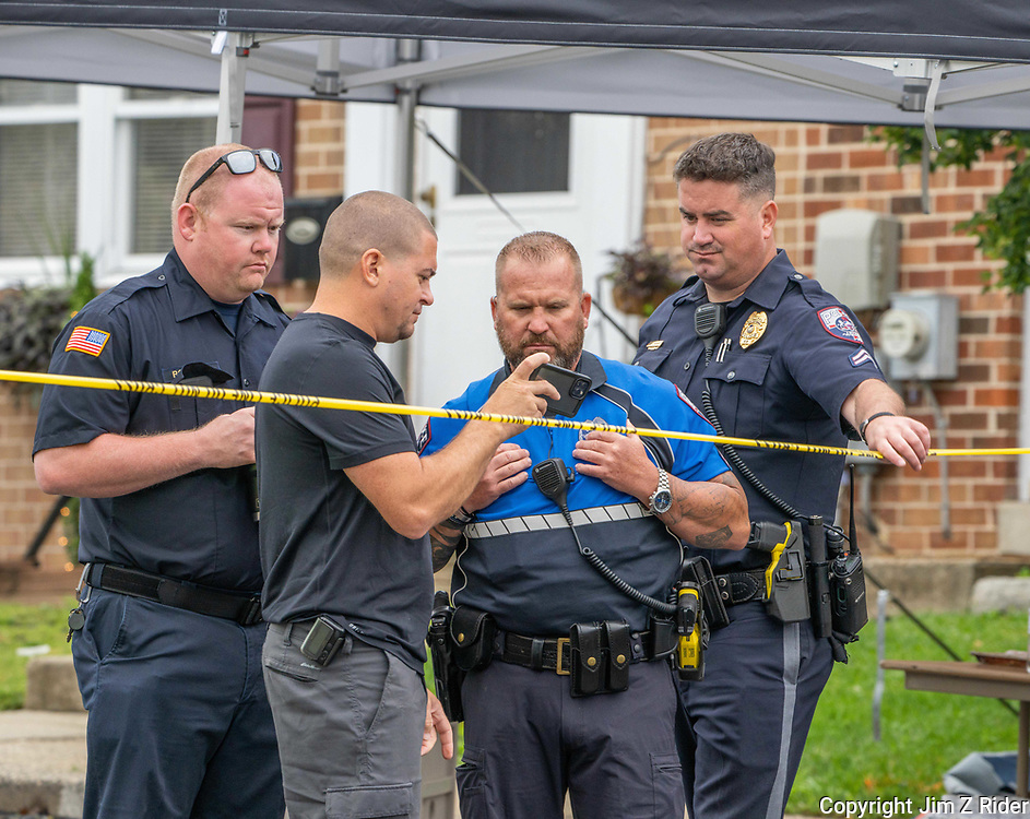 Lower Providence Township police and fire crews examine photos on the scene.