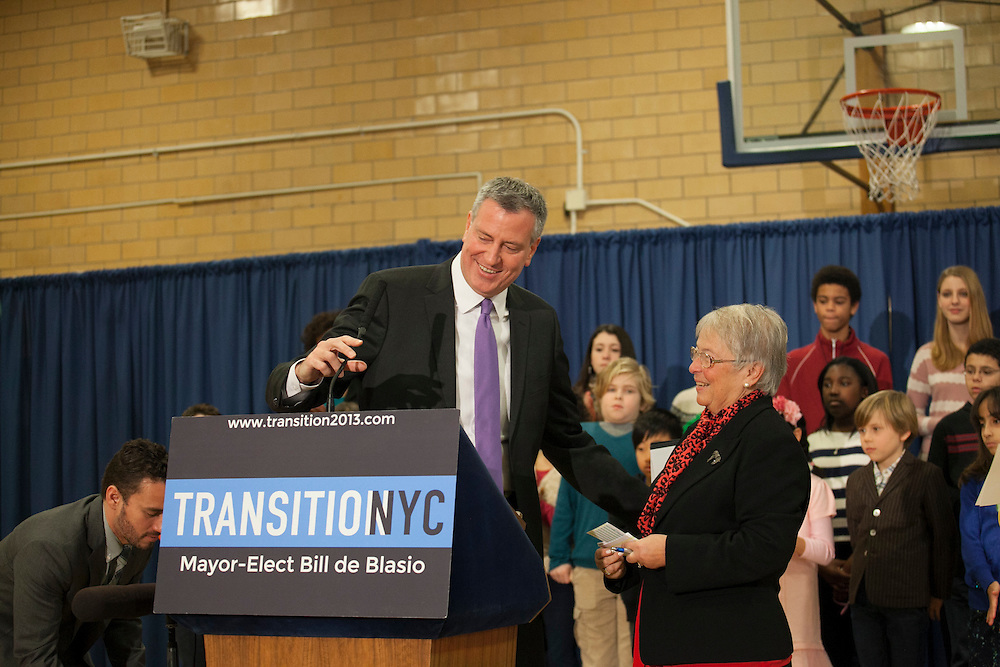 Mayor-Elect Bill de Blasio announces his appointment of Carmen Fariña, right, as Schools Chancellor at William Alexander Middle School in Park Slope, Brooklyn, NY on Monday, Dec. 30, 2013. <br /> <br /> CREDIT: Andrew Hinderaker for The Wall Street Journal<br /> SLUG: NYSTANDALONE