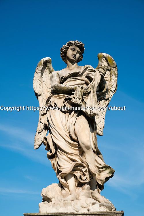 Statue on the  Ponte Vittorio Emanuele II bridge crossing the Tiber River near the Vatican City in Rome , Italy
