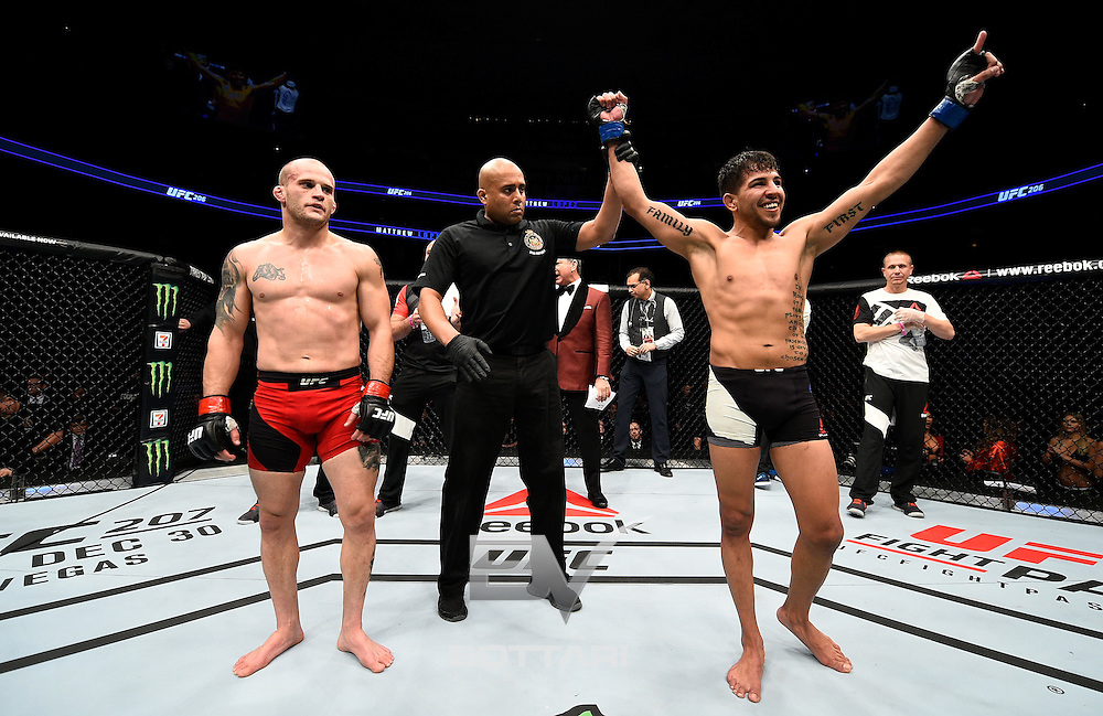 TORONTO, CANADA - DECEMBER 10:  Matthew Lopez celebrates after his unanimous-decision victory over Mitch Gagnon of Canada in their bantamweight bout during the UFC 206 event inside the Air Canada Centre on December 10, 2016 in Toronto, Ontario, Canada. (Photo by Jeff Bottari/Zuffa LLC/Zuffa LLC via Getty Images)