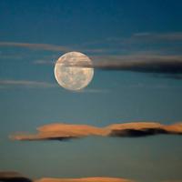 South America, Peru, Laka Titicaca. The Super Moon of June, 2013, in the skies above Lake Titicaca, Peru.