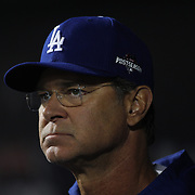 Los Angeles Dodgers coach Don Mattingly in the dugout during the New York Mets Vs Los Angeles Dodgers, game four of the NL Division Series at Citi Field, Queens, New York. USA. 13th October 2015. Photo Tim Clayton