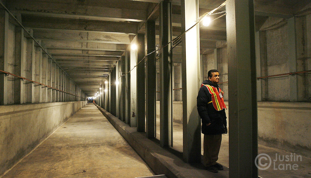A Metropolitan Transportation Authority worker stands inside a partially constructed tunnel of the new Second Avenue subway line before an official groundbreaking ceremony in New York, New York on Thursday 12 April 2007. The subway line, which is estimated to cost $17 billion,  has been discussed in the city for since the 1920s, and there have been three other official groundbreakings, but elected officials say that the first phase of the project will be complete by 2013.