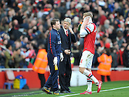 Arsenal manager Arsene Wenger looks on at Per Mertesacker ® during Barclays Premier League , Arsenal v Sunderland at the Emirates Stadium in London, England on Saturday 22nd Feb 2014.<br /> pic by John Fletcher, Andrew Orchard sports photography.