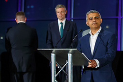 © Licensed to London News Pictures. 07/05/2016. London, UK. Britain First's London Mayoral candidate PAUL GOLDING reacting to new Mayor of London SADIQ KHAN's victory speech during the announcement of the election results at City Hall in London on Saturday, 7 May 2016.  Labour MP Sadiq Khan has declared his victory and accused his Conservative counterpart, Zac Goldsmith MP of using underhand tactics during the campaign. Photo credit: Tolga Akmen/LNP