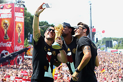 15.07.2014, Brandenburger Tor, Berlin, GER, FIFA WM, Empfang der Weltmeister in Deutschland, Finale, im Bild vl. Lukas Podolski (GER), Jerome Boateng (GER) und Mesut Oezil (GER) // during Celebration of Team Germany for Champion of the FIFA Worldcup Brazil 2014 at the Brandenburger Tor in Berlin, Germany on 2014/07/15. EXPA Pictures © 2014, PhotoCredit: EXPA/ Eibner-Pressefoto/ Pool<br /> <br /> *****ATTENTION - OUT of GER*****