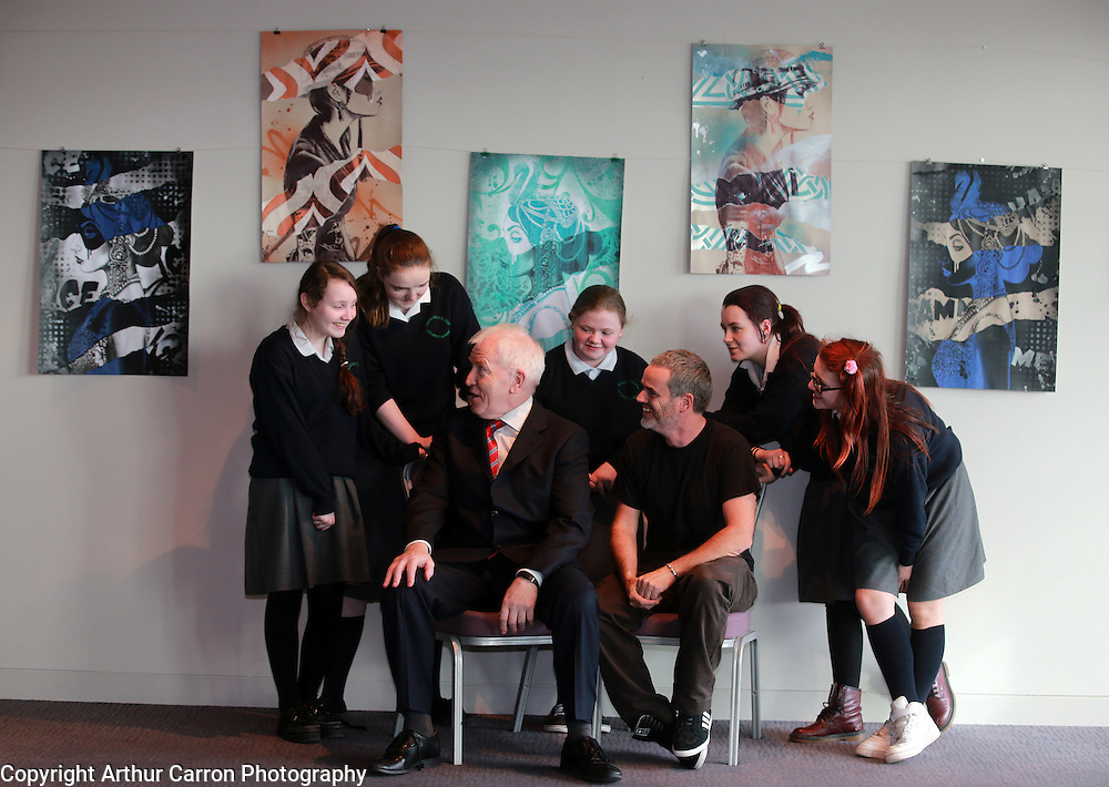1/4/14 Minister Jimmy Deenihan T.D and artist Finbar Dac with Leah Maher (left), Jasmine Delaney, Niamh Faulkner, Eire Greene and Nicola Byrne, 2nd year students at Ringsend Community College. at the launch, Finbar Dac,  the new Artist in Residence at the Gibson Hotel, Dublin Docklands, Dublin 1. Picture:Arthur Carron