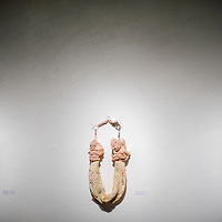 """031314       Cable Hoover<br /> <br /> Necklaces made of cloth remnants hang in Kristi Wilson's show """"Rethinking Sentimentality"""" at UNM-Gallup Friday."""