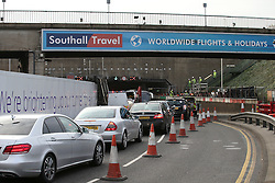 © Licensed to London News Pictures. 26/11/2015. London, UK. Traffic queued to enter the blocked tunnel. A group of Airport expansion activists cause traffic chaos by blocking off the inbound tunnel of Heathrow airport in London to protest against airport expansion.  Photo credit: Peter Macdiarmid/LNP