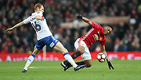 Football - 2016 / 2017 FA Cup - Fourth Round : Manchester United vs. Wigan Athletic <br /> <br /> Shaun MacDonald of Wigan Athletic and Anthony Martial of Manchester United during the match at Old Trafford.<br /> <br /> COLORSPORT/LYNNE CAMERON