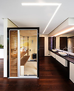 Glass and wood sauna in modern villa. Colored LEDs and nobody inside