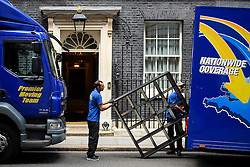 © Licensed to London News Pictures. 16/07/2016. London, UK. Shelving being placed in a van for George OSbone. Removal men begin to take items from numbers 10 and 11 at Downing Street at the end of the week that saw Prime Minister David Cameron leave and Theresa May arrive. Photo credit: Ben Cawthra/LNP