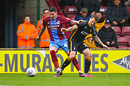 Adam Hammill of Scunthorpe United (47) and Billy Clarke of Bradford City (17) during the EFL Sky Bet League 1 match between Scunthorpe United and Bradford City at Glanford Park, Scunthorpe, England on 27 April 2019.