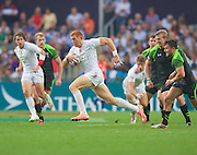 James Rodwell breaks through a Welsh pack on his way to scoring during the Hong Kong Sevens 2015 match between England and Wales at Hong Kong Stadium, Hong Kong on 27 March 2015. Photo by Ian Muir....during the Hong Kong Sevens 2015 match between ........... at Hong Kong Stadium, Hong Kong on 27 March 2015. Photo by Ian Muir.