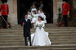 Princess Eugenie and her new husband Jack Brooksbank walk down the West Steps as they leave St George's Chapel in Windsor Castle following their wedding.