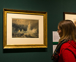 Pictured:  Turner art exhibition. Izzy McLaren from People's Postcode Lottery admires the Bell Rock lighthouse by Turner.  For more than a century the National Galleries of Scotland (NGS) have displayed an outstanding collection of Turner watercolours, from the 38 paintings bequeathed by Henry Vaughan in 1900. His will stipulated that the paintings should only be shown in January when daylight in Edinburgh is weak. The annual exhibition by artist Joseph Mallord William Turner (1775-1851) is supported by players of People's Postcode Lottery for the 7th year running. The focal point is a dramatic portrait of the Bell Rock lighthouse built by Robert Stevenson (1772-1850) which was commissioned 200 years ago by the lighthouse engineer to illustrate his book 'Account of the Building of Bell Rock Lighthouse'. Bell Rock is the oldest surviving rock lighthouse in the British Isles, first lit in 1811. It stands on a partially submerged reef near Angus, regarded by sailors as among the most dangerous places on the east coast of Scotland. The exhibition opens on New Year's Day at Scottish National Gallery and last for one month. 20 December 2018  <br /> <br /> Sally Anderson | EdinburghElitemedia.co.uk