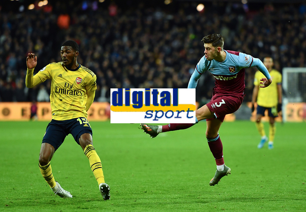 Football - 2019 / 2020 Premier League - West Ham United vs. Arsenal<br /> <br /> West Ham United's Aaron Cresswell crosses under pressure from Arsenal's Ainsley Maitland-Niles, at The London Stadium.<br /> <br /> COLORSPORT/ASHLEY WESTERN