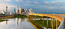 Panoramic image of Trinity River at flood stage reflecting against Dallas skyline, Texas, USA.